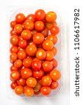 cherry tomato in plastic... | Shutterstock . vector #1106617982