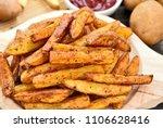 homemade crispy seasoned french ... | Shutterstock . vector #1106628416