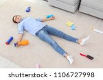 tired woman lying on carpet... | Shutterstock . vector #1106727998