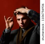 man in vintage style holds comb.... | Shutterstock . vector #1106756936