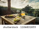 appetizer for two on a terrace... | Shutterstock . vector #1106831855