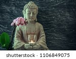 Buddha Statue With Candle In...
