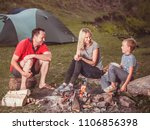 family near the fire in the... | Shutterstock . vector #1106856398