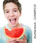 young teen boy eating watermelon | Shutterstock . vector #110689115