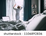 woman wakes up in luxury hotel... | Shutterstock . vector #1106892836