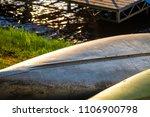 canoe kayak laying on shore...   Shutterstock . vector #1106900798