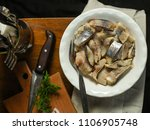 Stock photo tasty herring seafood on a plate a herring fish in marinade cuisine food background 1106905748