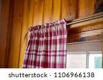 plaid curtain in cabin close up ... | Shutterstock . vector #1106966138