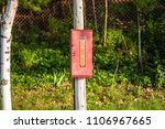 fire extinguisher outside pole...   Shutterstock . vector #1106967665