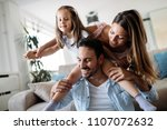 happy family having fun time at ... | Shutterstock . vector #1107072632
