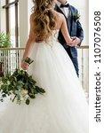 happy bride and groom dancing...   Shutterstock . vector #1107076508