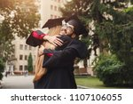 pair of students hugging on... | Shutterstock . vector #1107106055