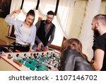 friends   guys and girls play... | Shutterstock . vector #1107146702