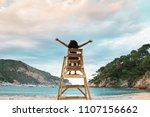 young woman sit on a lifeguard... | Shutterstock . vector #1107156662