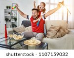 a family of fans watching a...   Shutterstock . vector #1107159032