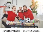 a family of fans watching a... | Shutterstock . vector #1107159038