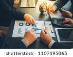 business team analyzing and... | Shutterstock . vector #1107195065