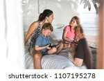 family talking on the bed | Shutterstock . vector #1107195278