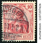 Small photo of GDR - CIRCA 1902: post stamp printed in Germany (Deutsches Reich) shows allegory Germania with imperial crown; mythological image of empire; Scott 68 A16 10 red; circa 1902