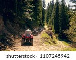 a tour group travels on atvs... | Shutterstock . vector #1107245942