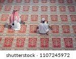 two religious muslim man...   Shutterstock . vector #1107245972