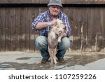 elderly farmer in hat  plaid... | Shutterstock . vector #1107259226