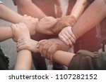 hands together joining concept  | Shutterstock . vector #1107282152