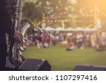 jazz musician playing outdoor... | Shutterstock . vector #1107297416