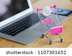 silver coin on shopping cart... | Shutterstock . vector #1107301652