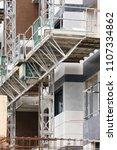 building facade under... | Shutterstock . vector #1107334862