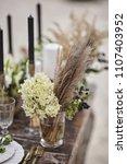 wedding table setting | Shutterstock . vector #1107403952