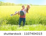 happy young couple in green... | Shutterstock . vector #1107404315