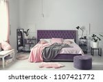 Stock photo interior of beautiful room with comfortable double bed 1107421772