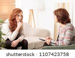 smiling woman talking to a... | Shutterstock . vector #1107423758