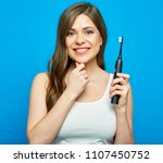 woman holding electric... | Shutterstock . vector #1107450752