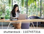 young businesswoman working... | Shutterstock . vector #1107457316