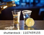 two glasses with a tequila and... | Shutterstock . vector #1107459155