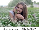 the girl is lying on a meadow | Shutterstock . vector #1107466022