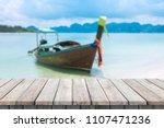 wooden desk or plank on sand... | Shutterstock . vector #1107471236