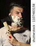 brutal shaving man . portrait... | Shutterstock . vector #1107483158