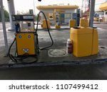 Small photo of fire extinguisher and refueling hoses yellow petrol station in the desert of the Israel Negev. Israel,Negev,June 2018