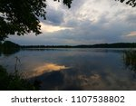stormy clouds over a lake  | Shutterstock . vector #1107538802