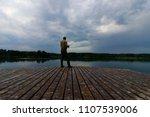 fisherman catching the fish... | Shutterstock . vector #1107539006
