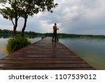 fisherman catching the fish... | Shutterstock . vector #1107539012