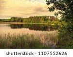 dawn on the lake. landscape... | Shutterstock . vector #1107552626