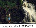 woman in hat enjoying nature... | Shutterstock . vector #1107556622