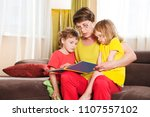 grandmother reading a tale to... | Shutterstock . vector #1107557102