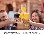 friends clinking glasses with... | Shutterstock . vector #1107568412