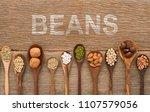 beans and lentils in wooden... | Shutterstock . vector #1107579056