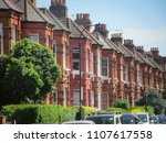 a row of residential terraced... | Shutterstock . vector #1107617558